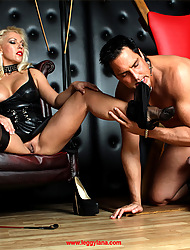 Mistress Lana makes her slave suck her trotters before she sucks his dick