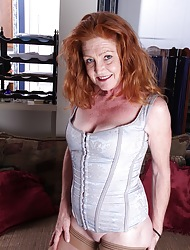 Busty mature redhead Veronica Smith dildos twat.