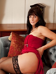 Elegant cougar Lelani Tizzie nude beside stockings.